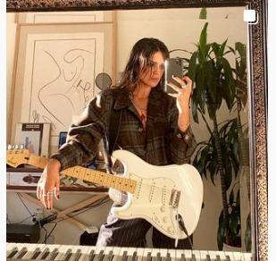 Sasha Calle with guitar.jpg